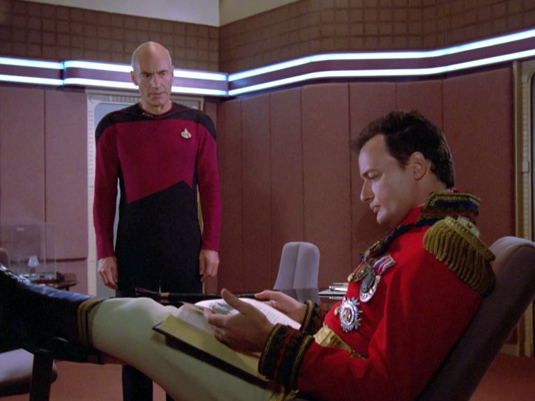 Captain Picard and Q in Picard's ready room, discussing Shakespeare